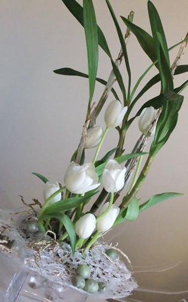 Wax fruit, glue nest, orchid plant and tulips