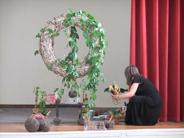 Placing the Orchid on wreath