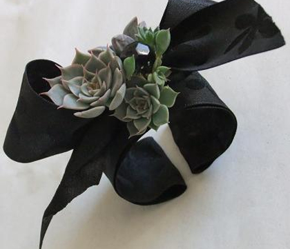 The plastic inside of a roll of Florist tape becomes a Wrist Corsage
