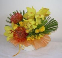 Cymbidium Friendship Arrangement in a Papier Mache Container