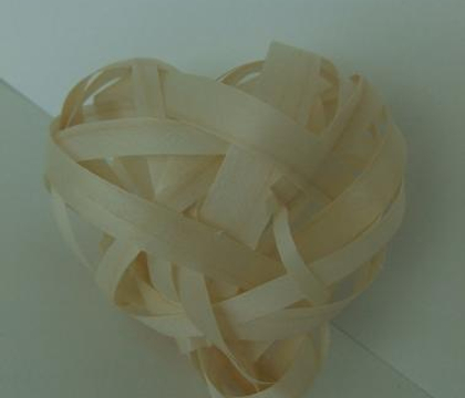 Weaving a heart from shaved wood strips