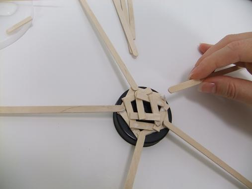 Glue on 5 wooden peg supports for the floral parasol