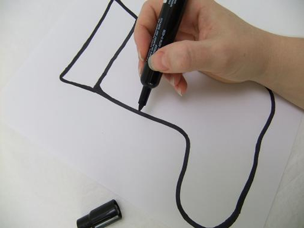Draw the Christmas stocking shape on paper