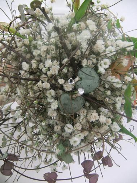 Forest floor snowball hand tied arrangement