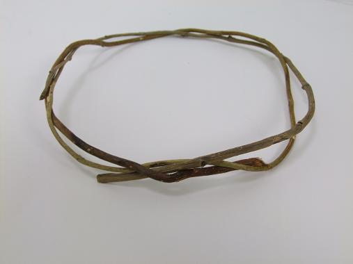 Gently bend the twig and guide it around the loop