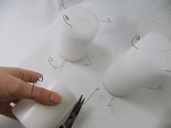 Continue adding wires to create a spiral up the candle