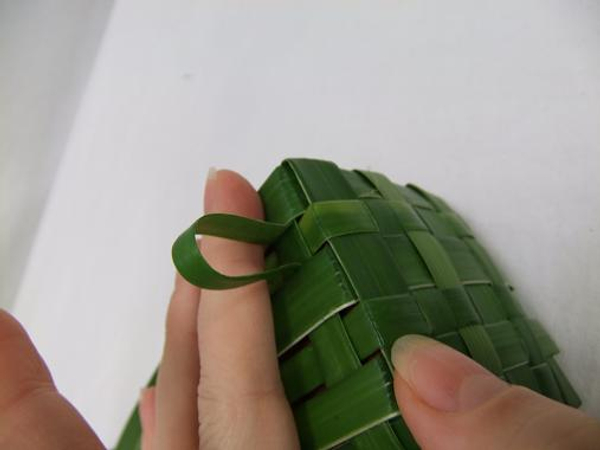 Cut the leaves at an angle and weave it through on itself to create a neat overlap