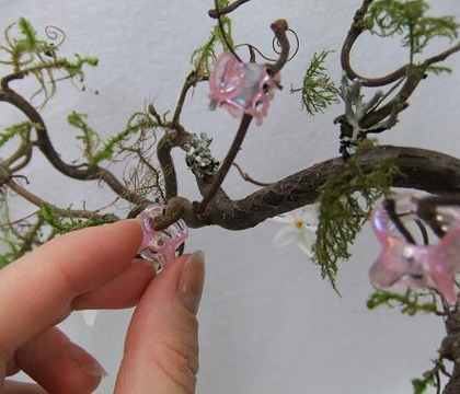 Butterfly hairclip claws to hold twigs in place while glue dries