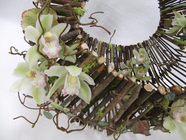 Cymbidium orchids and hazel twigs dress the handbag