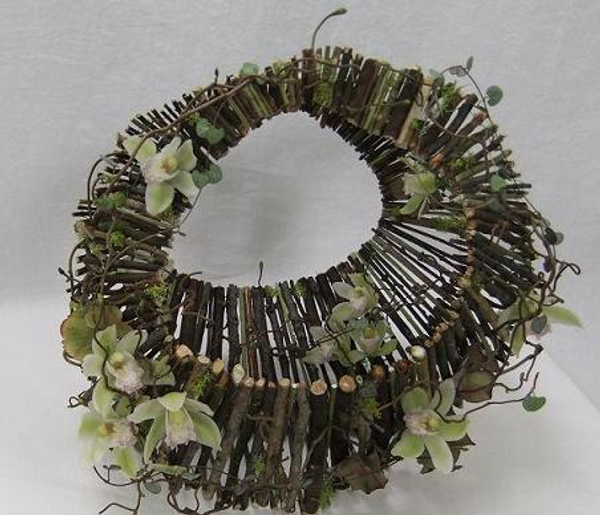Moss covered twig handbag floral art design