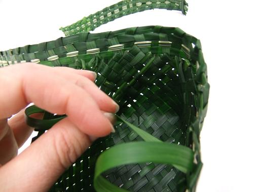 Continue stitching the trim all the way around the grass basket