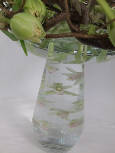 Position orchids under water with a corsage magnet