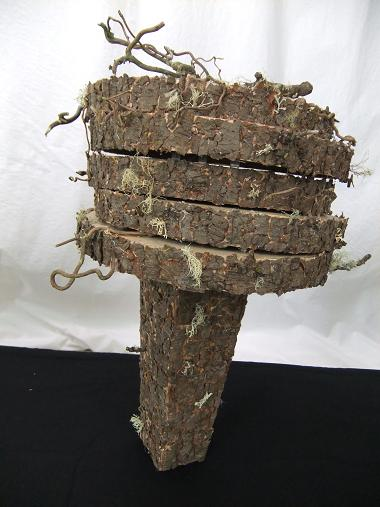Cover cardboard and metal shapes to create a natural looking armature.