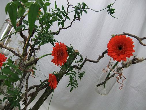 Floral art design with Gerbera and twigs.