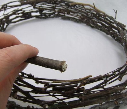 Glue a round stacked twig platter