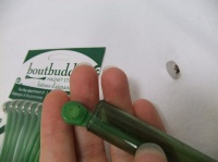 Use a Boutbuddy corsage magnet to hang test tubes