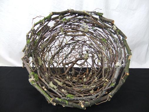 Stack and glue twigs to create a twig nest