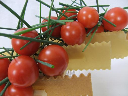Vine tomatoes, lasagne and chive centerpiece.