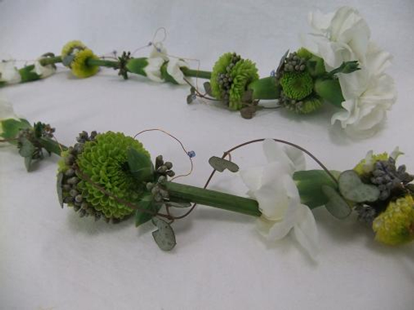 Thread flowers to create floral string that can be worn as a lariat necklace