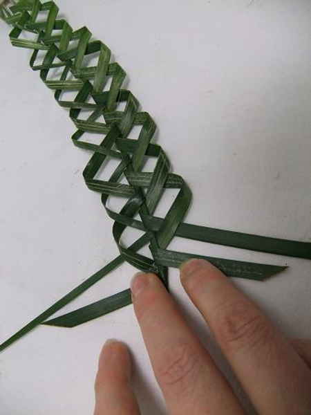 Continue the plaiting pattern.