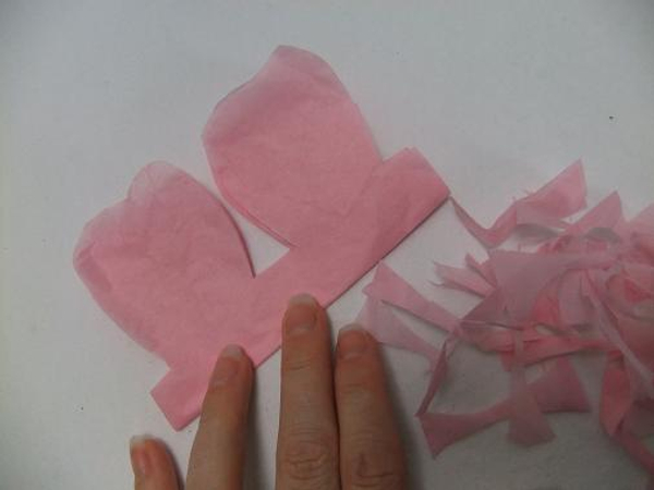 Fold and cut the tissue paper to make a petal garland.