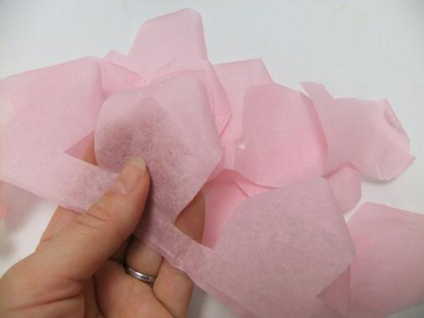 Roll the tissue paper petals at the top.