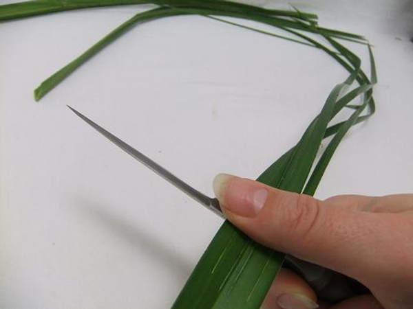 Run the back of your knife along the leaf to make it pliable