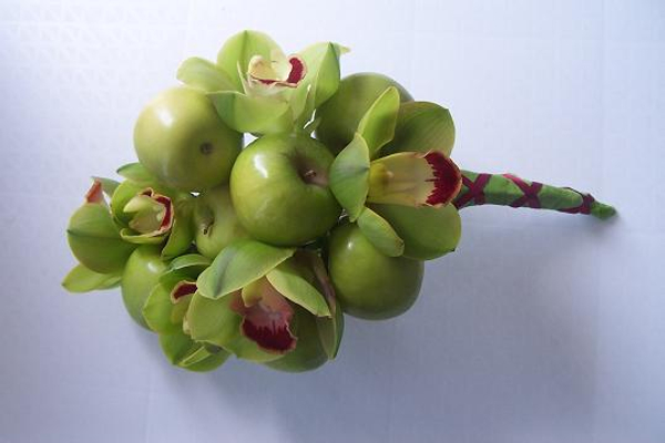 Wire the apples to create an armature for the orchids.