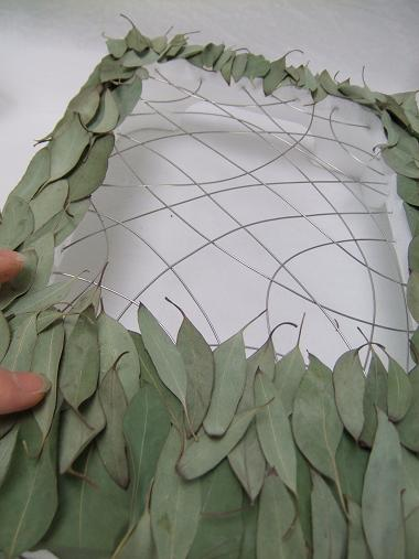 Create a harmonious pattern with the dried leaves.