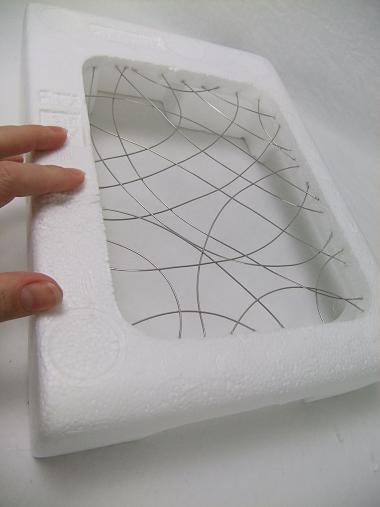Styrofoam and wire grid.
