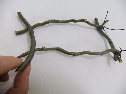 Use four twigs to build two side panels.