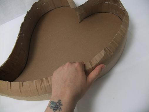 Break the sharp edges by bending the cardboard in your hand.