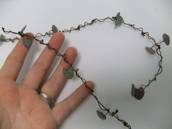 Delicate twig and rosary vine garland.
