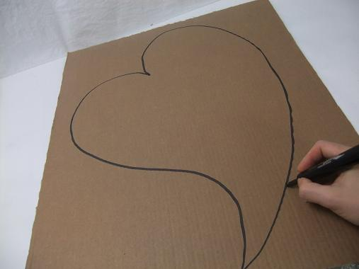Draw a large heart shape on the cardboard.