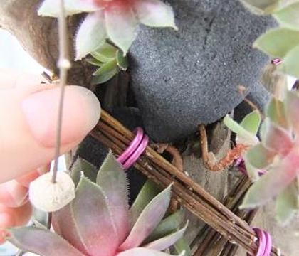 Banding a bundle of twigs