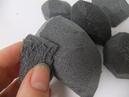 Sand the pebble to a smooth shape with a small piece of foam.
