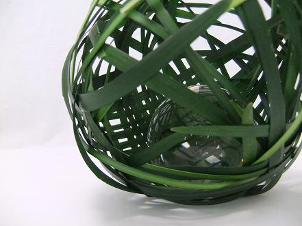 Glass sphere in a grass sphere.