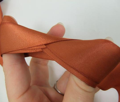 Infinity fold for storing ribbon