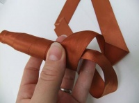 Wrap a gift test tube with ribbon