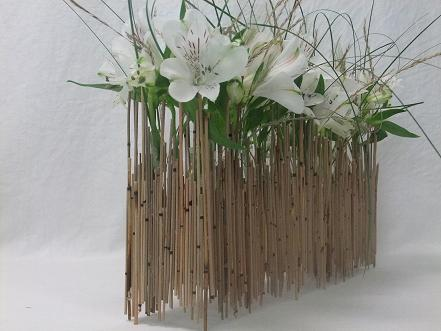 Alstroemeria and grass in a Mikado reed armature.