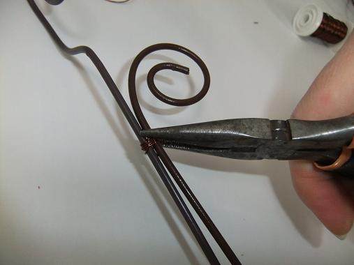 Cut the wire short and fold any sharp ends in