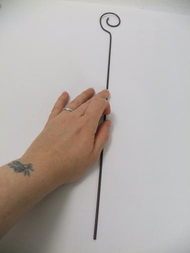 Place the wire on a flat surface