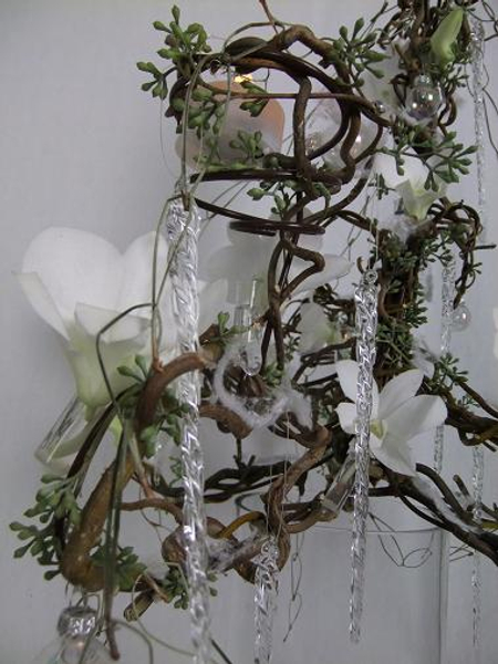 Twisted hazel branches and willow stems, eucalyptus and Dendrobium orchids