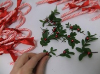 Dress up candy cane favors with boxwood, ribbon and beads