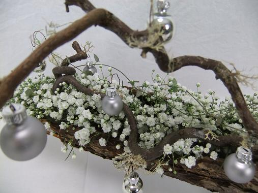 Hang a few baubles from mossy twigs.