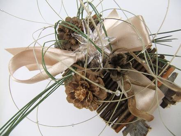 Pine needles, pine cones and ripped flax to decorate the twig gift box