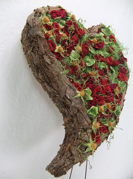 Cover cardboard with bark to create a heart shaped armature.