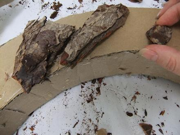 Cover the arch shape with chips of bark