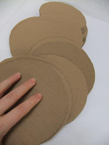 Cut a stack of cardboard circles.