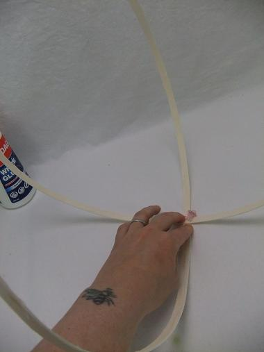 Measure out two sections of midelino cane coils and glue it in the middle point
